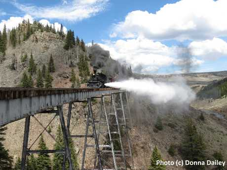 2015-06-30-1435707855-5084979-Cumbres_Toltec_Scenic_Railroad_26_train_blowing_steam_on_bridge.jpg