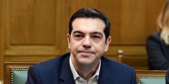 2015-07-06-1436207685-7027196-Tsiprasunhappy.jpg