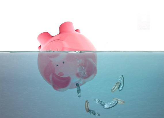 2015-07-23-1437672753-9426231-drowningpiggybank.jpg