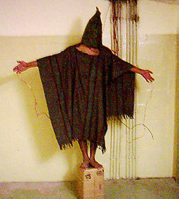 2015-07-24-1437717668-8116117-AbuGhraibAbusestandingonbox.jpg