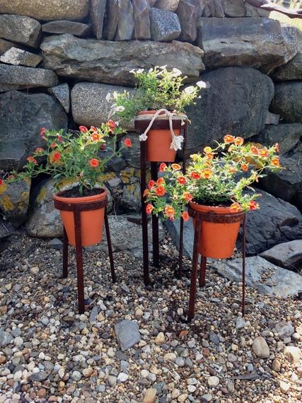 2015-07-28-1438045473-230976-rustedplantstandswithterracottapots.jpg