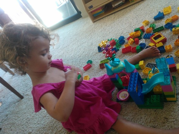 Girl playing with Legos Copyright Tracy Cutchlow