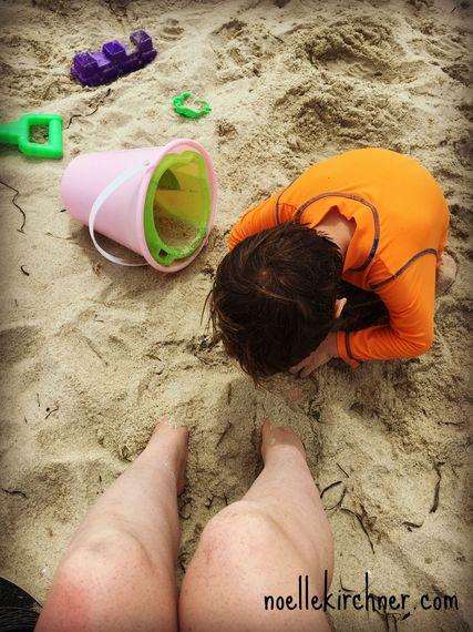 2015-08-24-1440440414-2371953-SandBurying.jpg