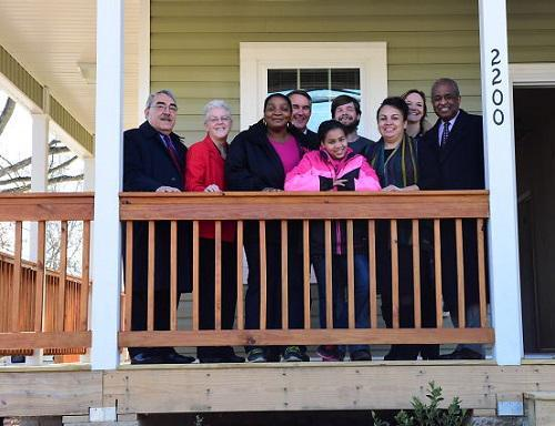 Administrator McCarthy with a family outside an ENERGY STAR certified home.
