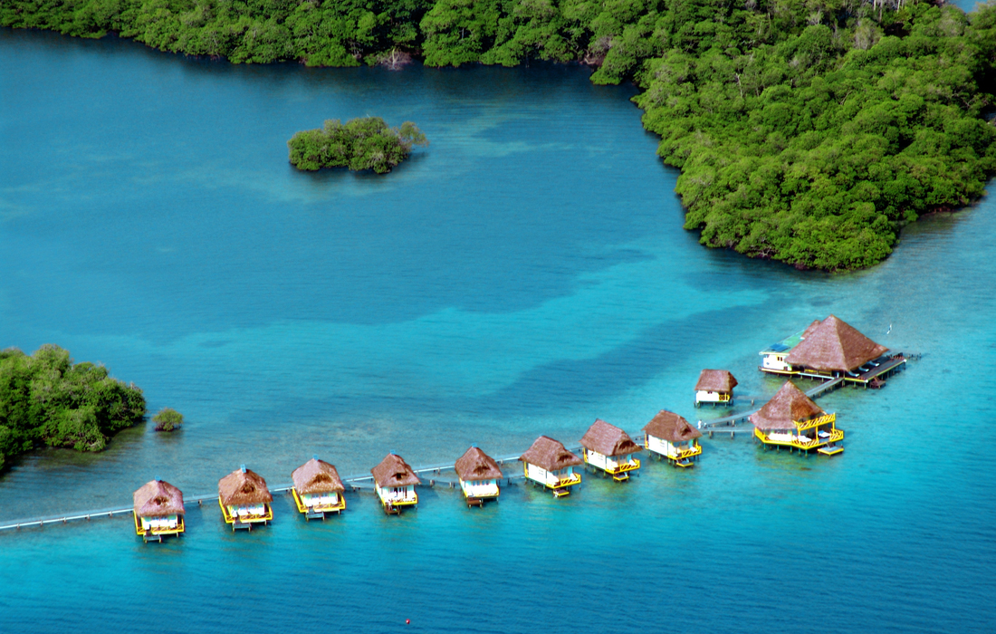 5 insane overwater bungalows you can actually afford for Bungalows sobre el mar en mexico