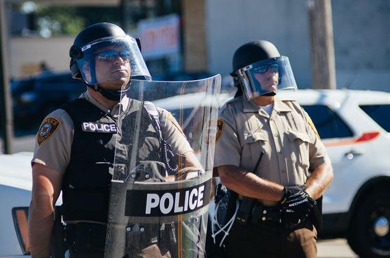 2015-09-06-1441563758-4177017-CWCONSTANCEHUFFPOBLOGPolice_in_riot_gear_at_Ferguson_protestsfergusonwikimedia.jpg