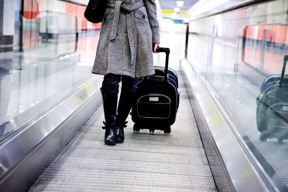 2015-09-18-1442604664-339280-WomanCoatAirport_800px.jpeg