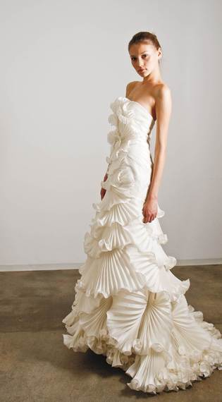 2015-09-18-1442608069-8207001-weddingdresswithtonsofruffles_CNP.jpg