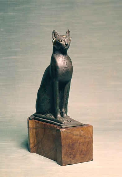 2015-10-28-1446060617-1949973-Egyptian__Statue_of_a_Seated_Cat__Walters_54403__Three_Quarter.jpg