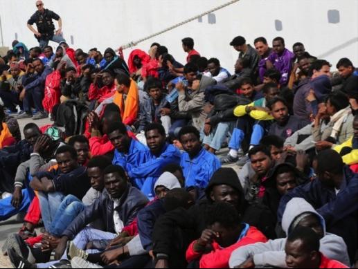 2015-10-30-1446229654-6851076-refugeeslineup.png