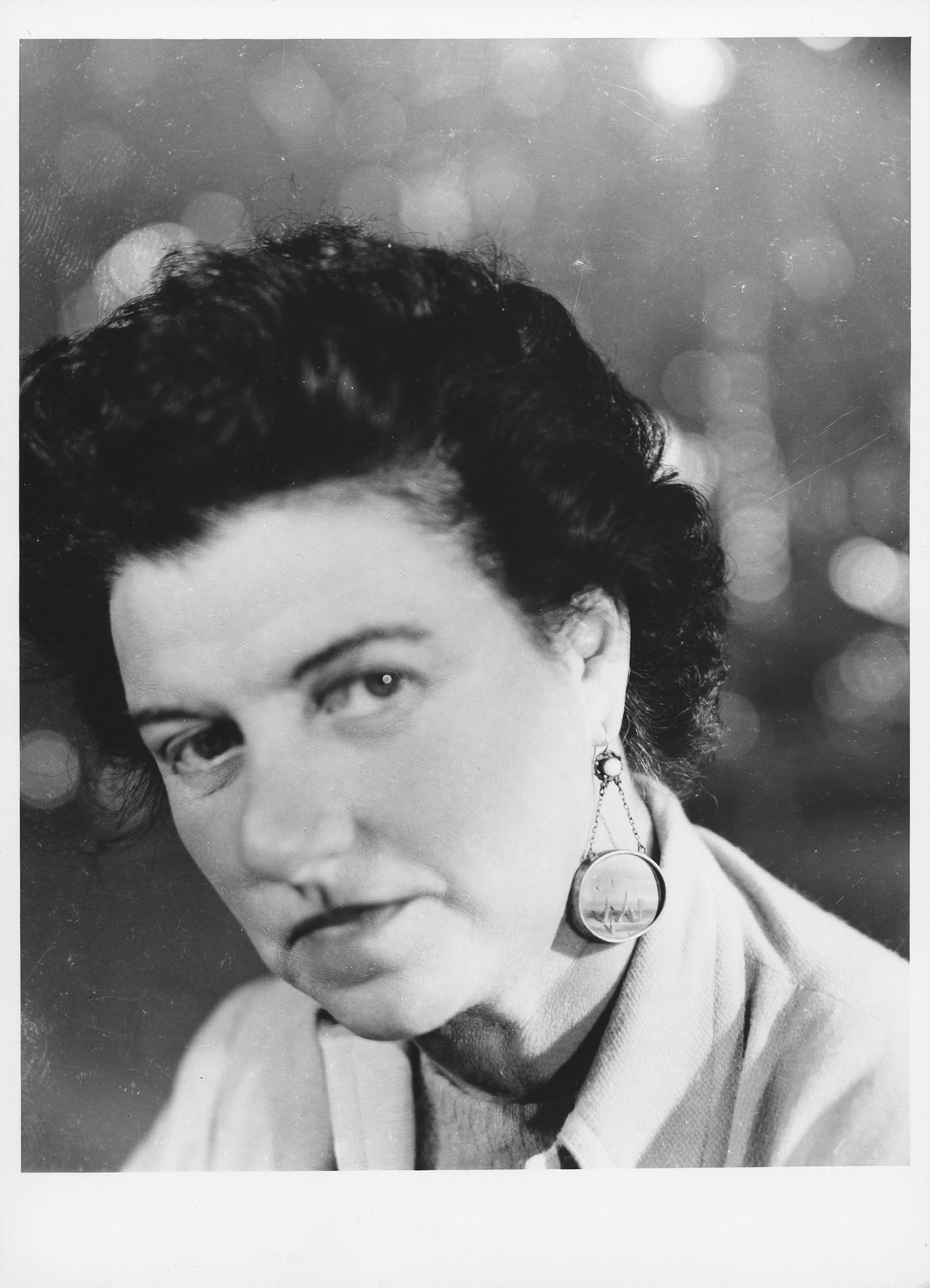 Peggy Guggenheim wearing a pair of earrings made for her by Yves ...