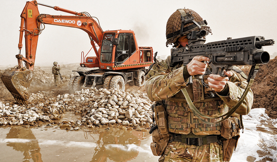 2015-11-13-1447387940-2645345-TalibanSoldier_Keeps_Watch_During_Construction_of_Route_Trident_in_Helmand_Afghanistan_MOD_45152225.jpg