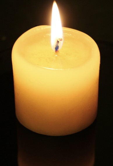 2015-12-07-1449489389-9734619-Candleflameandreflection.jpg
