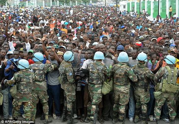 2015-12-08-1449603776-7152287-hungryearthquakeHaitiansconfrontUNforces2010CreditAFPandGettyImagesccr307.jpg