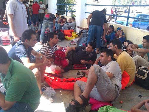 2015-12-09-1449676323-5287883-Refugeeswaiting.jpg