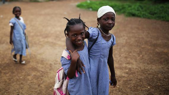 2015-12-16-1450302453-1997162-girlswalkstreetsforecariahguinea.jpg