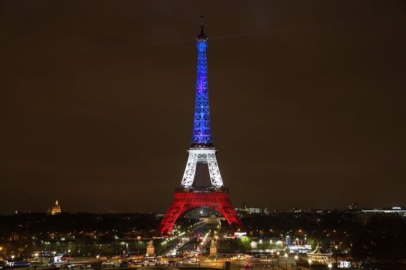 2015-12-17-1450343347-9774591-The_Eiffel_Tower_lit_up_in_French_colours_after_the_November_2015_Paris_attacks.jpg