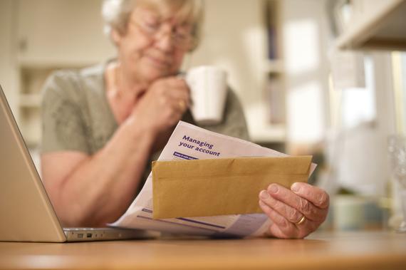 2015-12-21-1450705897-7108671-seniorwomanbankstatement.jpg