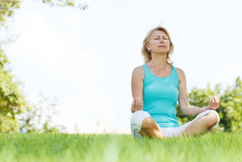 2015-12-23-1450912524-4929731-Meditationolderwomanoutsideinblue.jpg