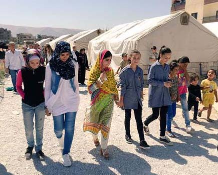2015-12-26-1451133187-1432810-NobelPeacePrizelaureateMalalaYousefzaivisitsSyrianrefugeesinLebanoncourtesyEasonJordan.jpg