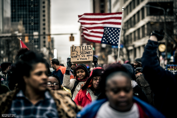 2016-01-07-1452177517-4666251-1UnidentifiedprotestermarchesthroughdowntownCleveland.jpg