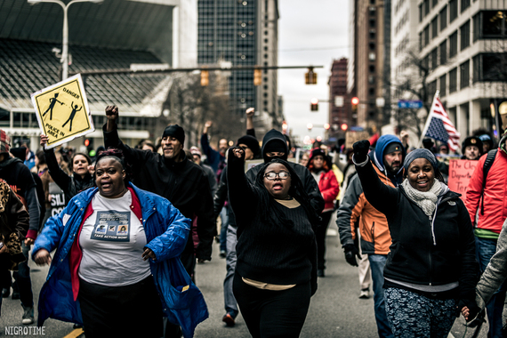 2016-01-07-1452178274-9657555-4AlanaBellecentermarchingthroughdowntownCleveland.jpg