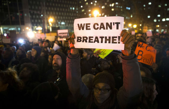 2016-01-26-1453767203-4658644-eric_garner_nypd_protest_ap_img_5.jpg