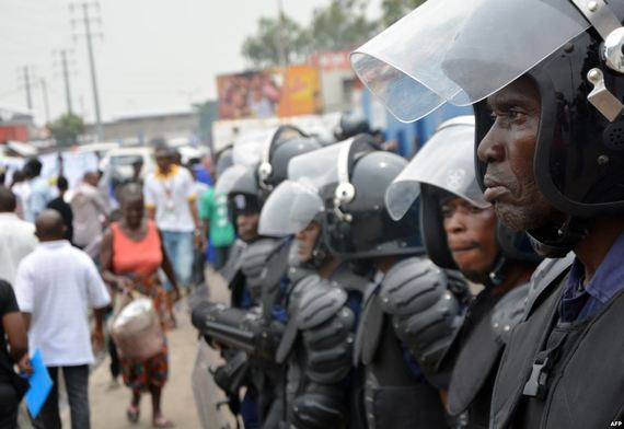 Police stand guard following demonstrations in Kinshasa, Democratic Republic of Congo, Jan. 12, 2015.