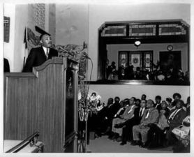 2016-01-26-1453808119-6342419-MartinLutherKingspeakinginPasadenain1960.png