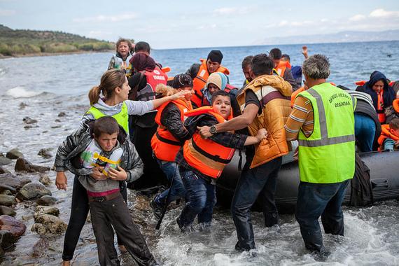 2016-01-28-1453988753-8051683-SyrianrefugeesarrivinginGreecebyCAFODPhotoLibraryflickr.jpg