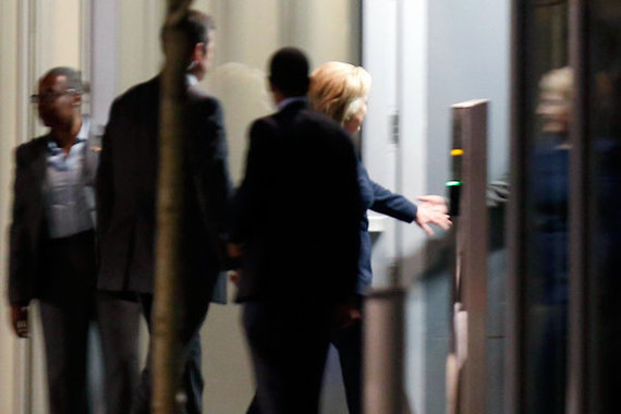 Clinton enters the Franklin Square Capital Partners headquarters through a back entrance. Credit: Yong Kim