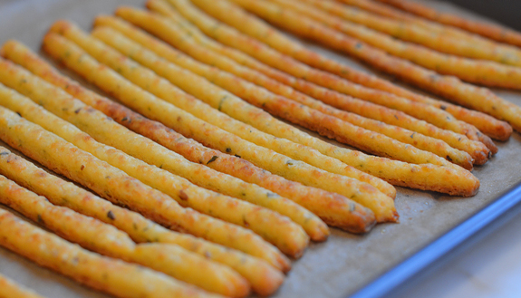 These crisp and flaky cheese straws are specked with fresh herbs and ...