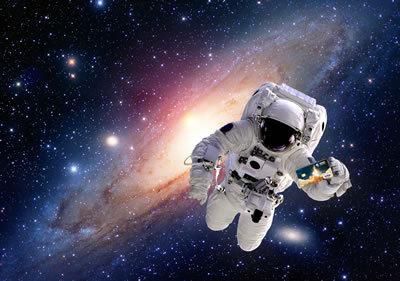 2016-03-07-1457394338-6417703-astronautgalaxybackgroundholdingcard_400h.jpg