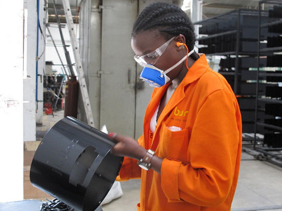 BURN's quality inspector Cindy checking the powder coating on the outside of a stove before final assembly