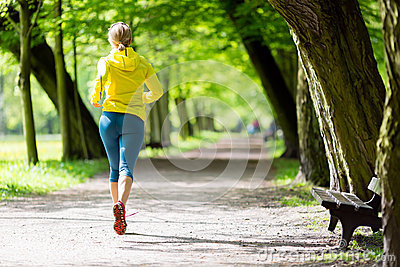 2016-03-26-1459005083-567184-womanrunnerrunningjoggingsummerparkwalkingnatureexercisingbrightforestoutdoors40177479.jpg
