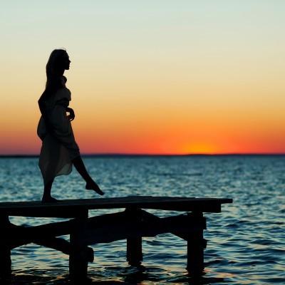 2016-04-05-1459899784-242305-WomanSunsetPier.jpg