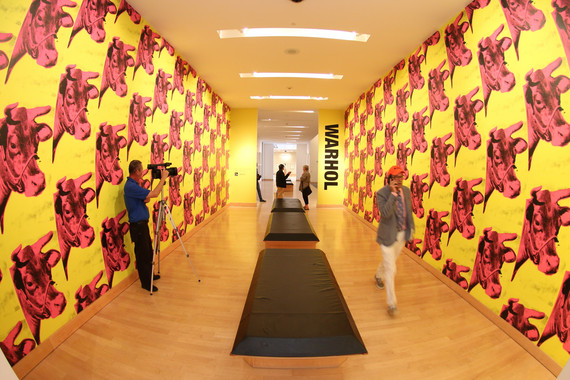 2016-04-11-1460417793-2870328-3.InstallationviewCowwallpaperWarholexhib.BocaRatonMuseum.jpg