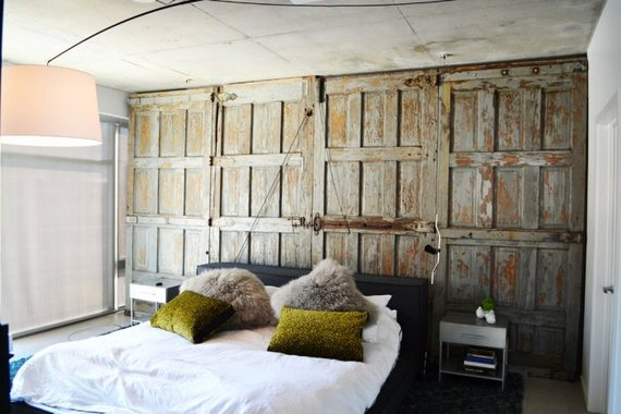bedroom with an old barndoor as a wall