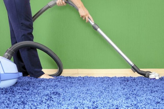 Angie's List Service Provider vacuuming carpet