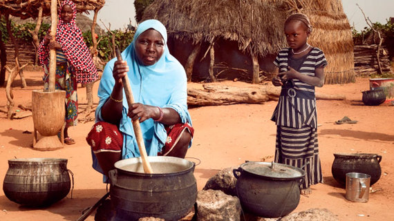A woman in a Niger village cooks for her family. Photo © Stephan Gladieu/World Bank