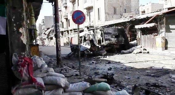 2016-05-22-1463926795-8390609-AleppoBombed_out_vehicles_Aleppo.jpg