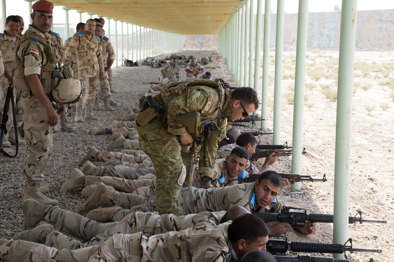 2016-05-22-1463928464-1138776-AleppoAn_Australian_soldier_with_Task_Group_Taji_assists_an_Iraqi_soldier_assigned_to_the_23rd_Iraqi_Army_Brigade_with_his_M16_rifle_during_a_range_at_Camp_Taji_.jpg