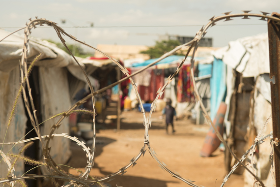 2016-06-07-1465336597-9147890-SouthSudancampbarbedwire.jpg