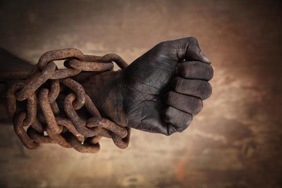 2016-06-08-1465391110-9431106-SlaveFist.jpg