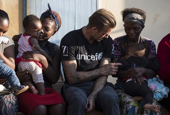 2016-06-08-1465400075-6374908-un021433_david_beckham_spends_time_with_moms_and_babies_in_swaziland.jpg