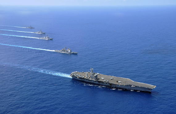 2016-06-10-1465572241-7875276-US_Navy_100215N8421M185_Ships_operate_in_formation_in_the_South_China_Sea.jpg