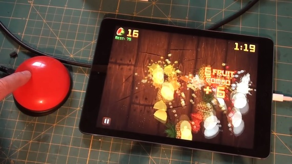 Fruit Ninja on an iPad, being played with an external button