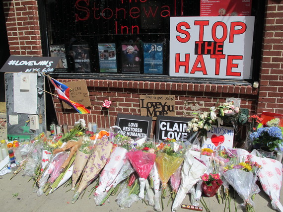 2016-06-24-1466792087-6718553-StonewallInn_Orlandomemorial_AndrewDallosFlickrCCBYNCND2.0.jpg