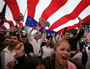 2016-07-02-1467470413-3612719-ImmigrantrightsactivistsdisplayAmericanflag.jpg