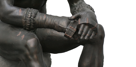 A bronze statue, 'The Boxer of Quirinal.' Sometimes ancient Greek boxers would bribe their opponents.